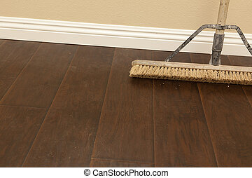 Push Broom on a Newly Installed Laminate Floor and Baseboard...