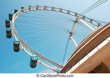 Singapore flyer against clear blue sky