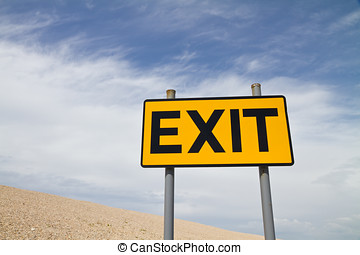 Yellow and Black Exit Sign against the sky