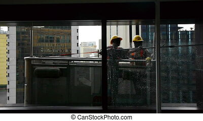 Windows cleaners in a skyscraper