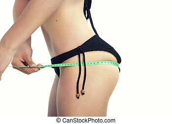 Woman in underwear measuring her bottom.It is not isolated