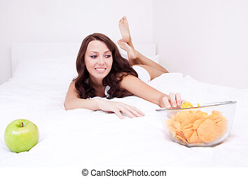 woman with apple and chips
