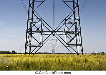 Energy line - High voltage meta pillars in the middle of a...