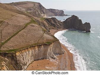 Dorset coastline looking down on Durdle Door, a natural sea...