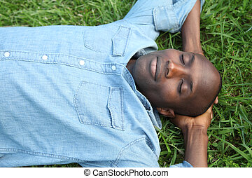Man taking a nap in park