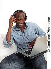 Black man listening to music on internet
