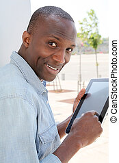 Man in urban area using electronic tablet