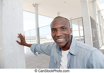 Portrait of relaxed man in urban area
