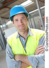 Portrait of young worker with security helmet