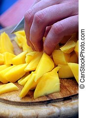 cutting mango slices