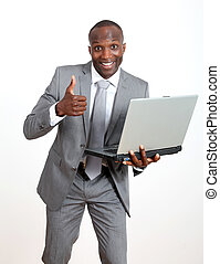 Joyful businessman with laptop computer