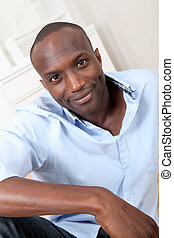 Handsome black man relaxing at home
