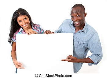 Cheerful couple showing message on whiteboard