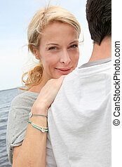 Happy woman relaxing on husband's shoulder