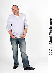 Senior man standing on white background with ignoring look
