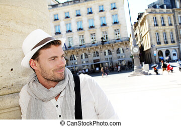 Portrait of handsome man in the town of Bordeaux