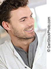 Portrait of handsome man leaning on wall