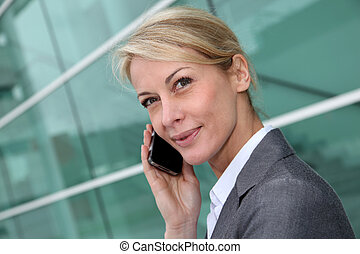 Close up of middle aged woman talking on cellphone