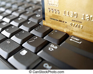 Online shopping - Golden credit card on computer keyboard