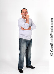 Senior man standing on white background with hand on chin