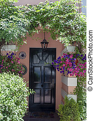 Entrance of a house in Gibraltar with the door surrounded by...