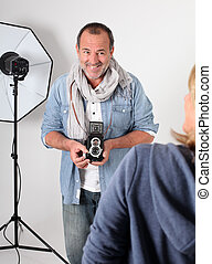 Photographer in photo session in studio