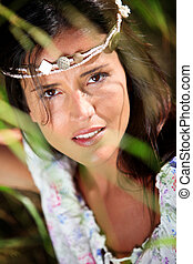 Gypsy girl with neacklace around her head