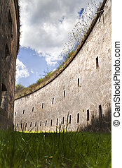 High curved walls - Formidable moat of a big fortress in...