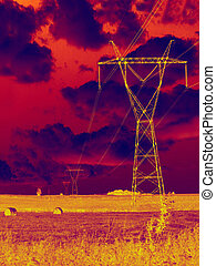 Electricity solstice - Silhouette of electricity pylon after...