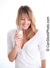 Beautiful woman holding glass of milk