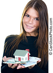 The business woman with the toy house and banknotes