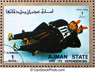 Postage stamp Ajman 1973 Two-man Sledge, Winter Olympics