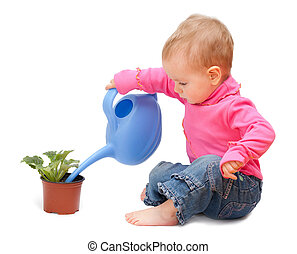 Adorable one-year old baby watering pot with a flower....