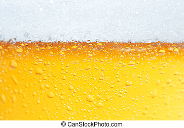 Beer an Foam - Close-up picture of a beer with bubbles and...