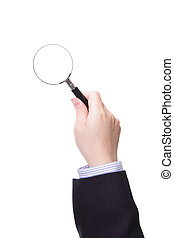 Magnifying glass in business man hand