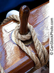 Rope control the sails, tied to a wooden beam