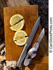 Two knife and cut on lobules lemon