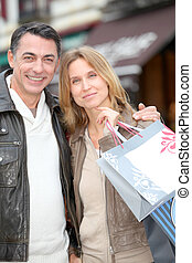 Couple doing shopping in town