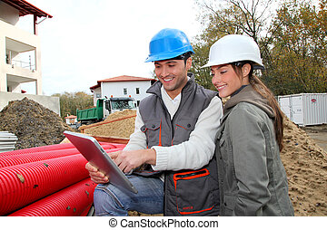 Architect an site supervisor on construction site