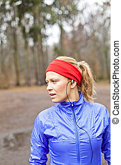 Woman runner exercising in winter forest