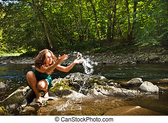 Young  woman playing with water