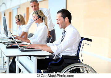 Office worker in wheelchair