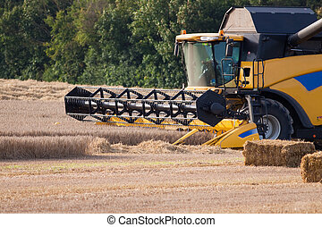 Combine Harvester at work in a cereal field