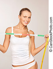 young beautiful woman with measure tape - picture of young...