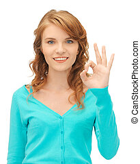 teenage girl showing ok sign - bright picture of teenage...