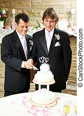 Gay Wedding - Grooms Cut Cake - Two handsome grooms cutting...