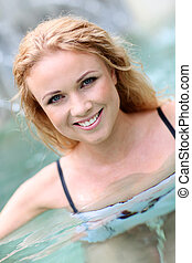 Closeup of blond woman in spa pool