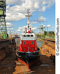Fire-boat in dock - Fire-boat in floating dry dock. Gdansk,...