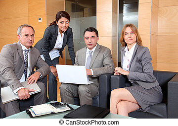 Group of associates meeting in lounge