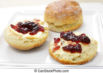 English scones with jam - Traditional English scones halved...